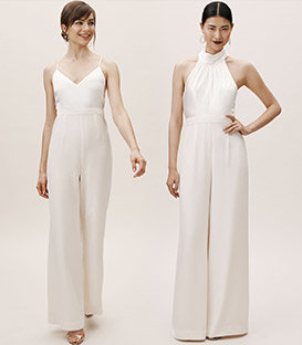 Models pose in a little white dress and a floor length jumpsuit.