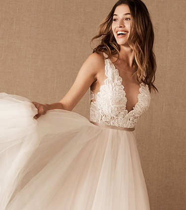 Bride swishes the tulle on her plunge-neck ballgown.