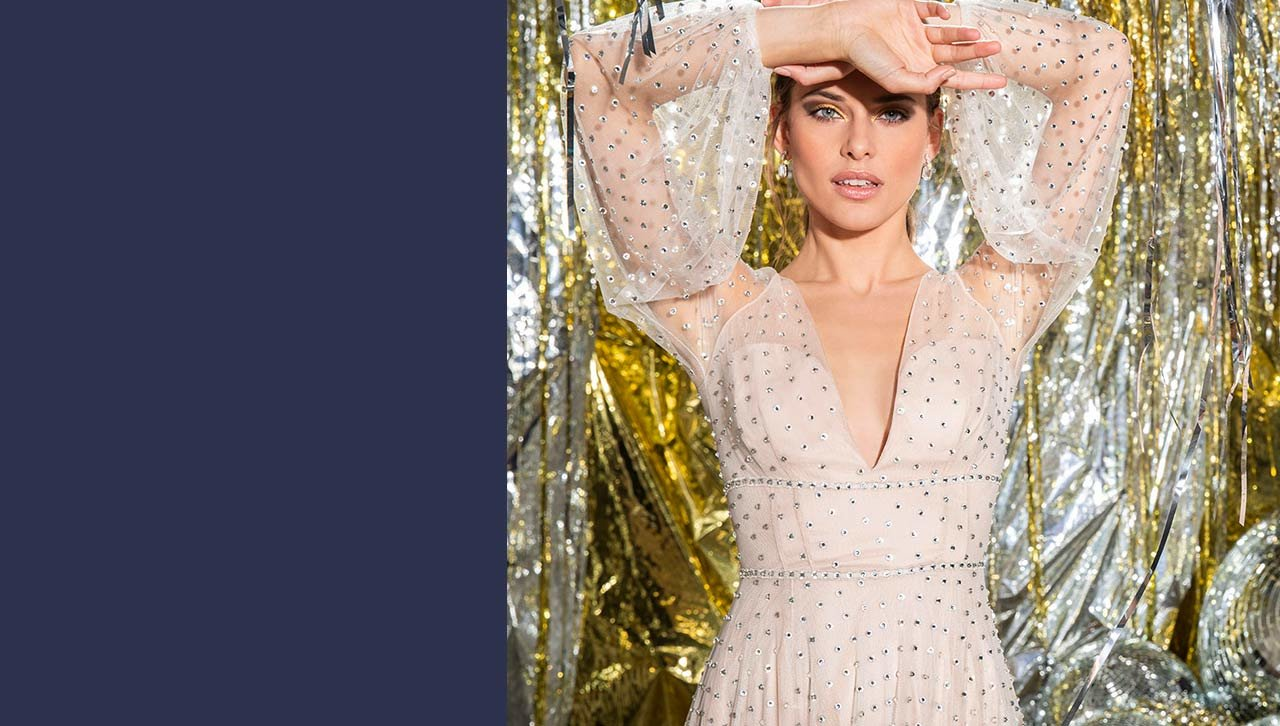 Long sleeve gown with a plunge neck and sparkly embellishments.
