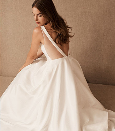 3 models pose in bridal occasion outfits: a halter jumpsuit, a sparkly plunge-neck maxi dress, and a strapless midi dress.