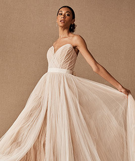 Bride moves in a long white ballgown.
