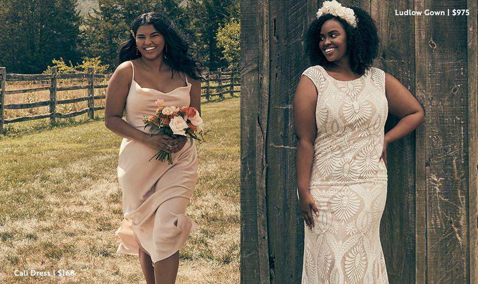 Left Image: Model standing against fence with a foot resting on it in pink Cali Dress in plus size, $168. Right Image: Bride standing against rustic wooden wall smiling to the side with a floral headhand and column Ludlow Gown in plus size, $975.